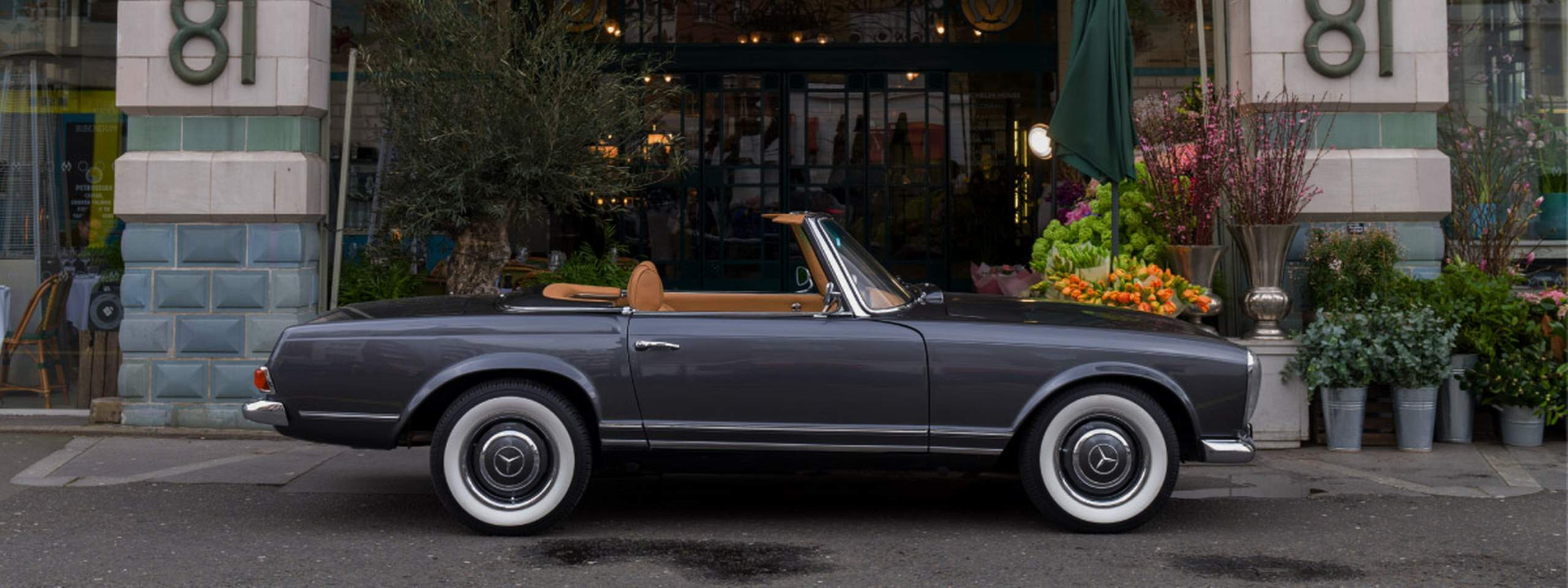 "A photo of a classic car Mercedes-Benz ""Pagoda"" turned electric"