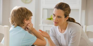 Mother discussing with boy.