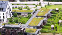Modern residential complex with green roofs