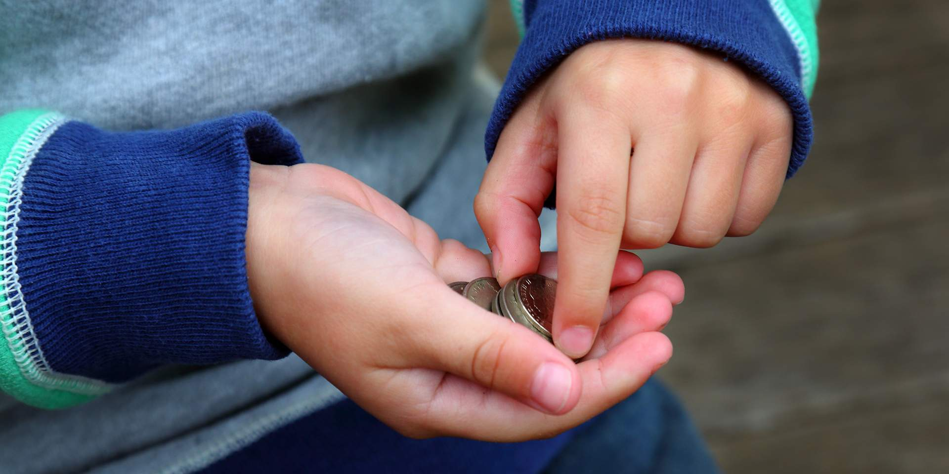 Child holding coins