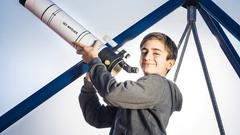 Thomas is saving for a telescope with Viva Kids.