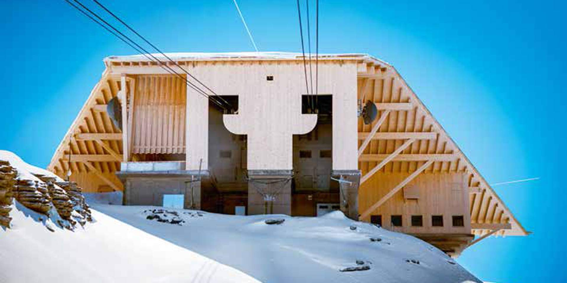 Suspended barn: The cable car docks directly at the new summit restaurant designed by Herzog & de Meuron at the top of the Chäserrugg mountain.